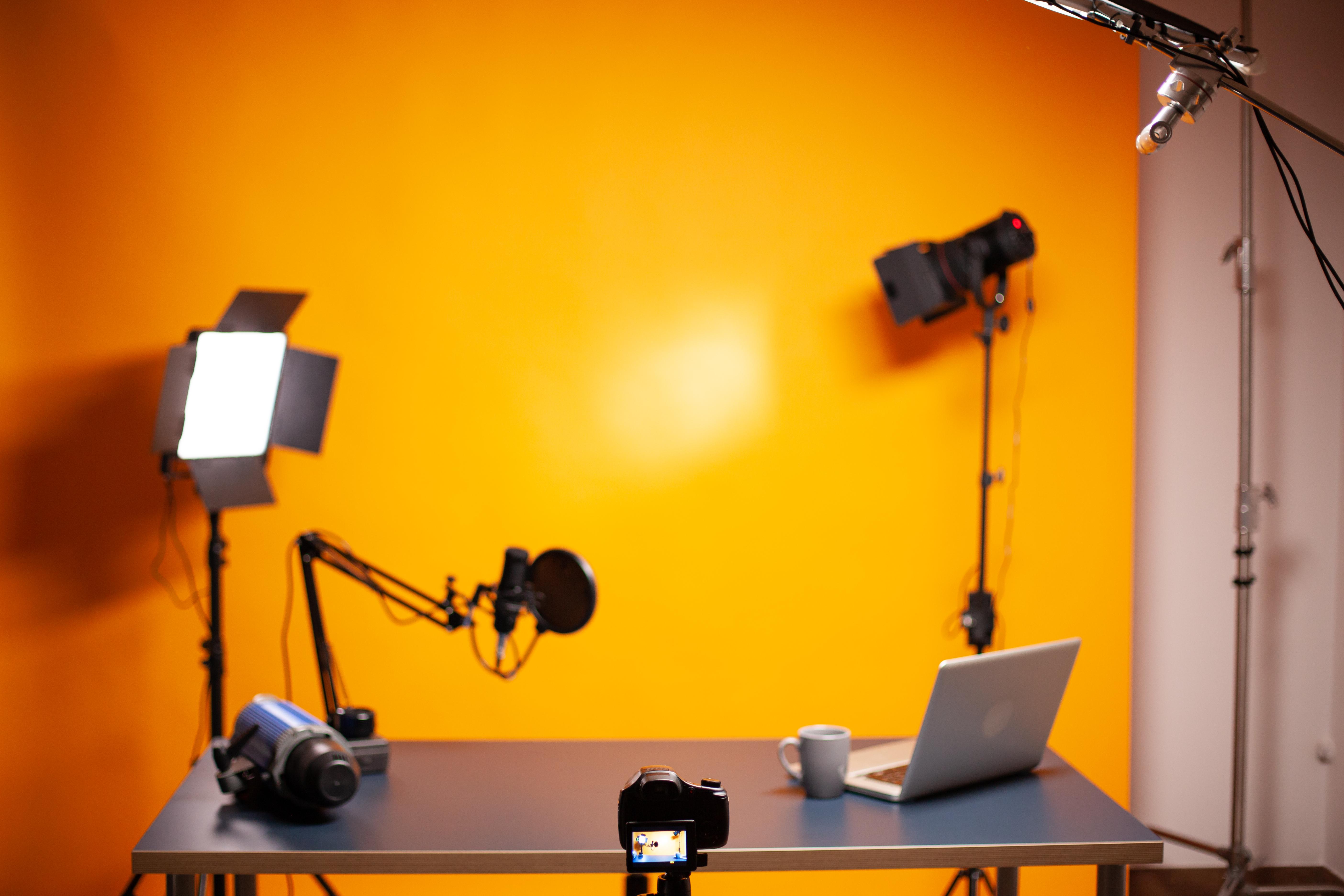 professional-podcast-vlogging-setup-studio-with-yellow-wall.jpg
